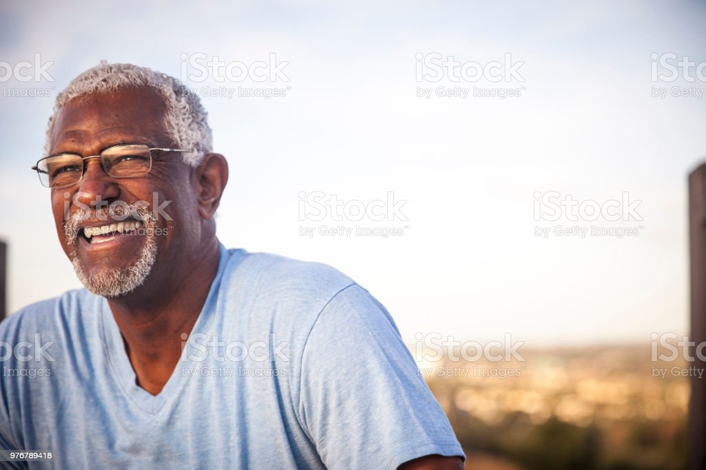 Portrait of a Smiling Senior Black Man stock photo