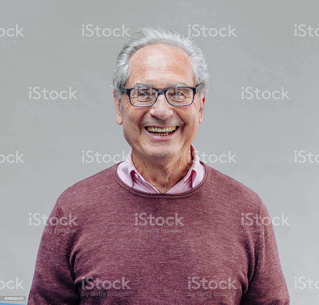 Portrait of a Smiling Senior Business Man stock photo