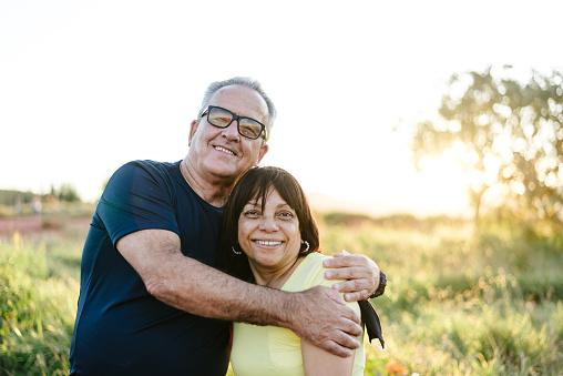 Portrait of a smiling senior couple on the farm