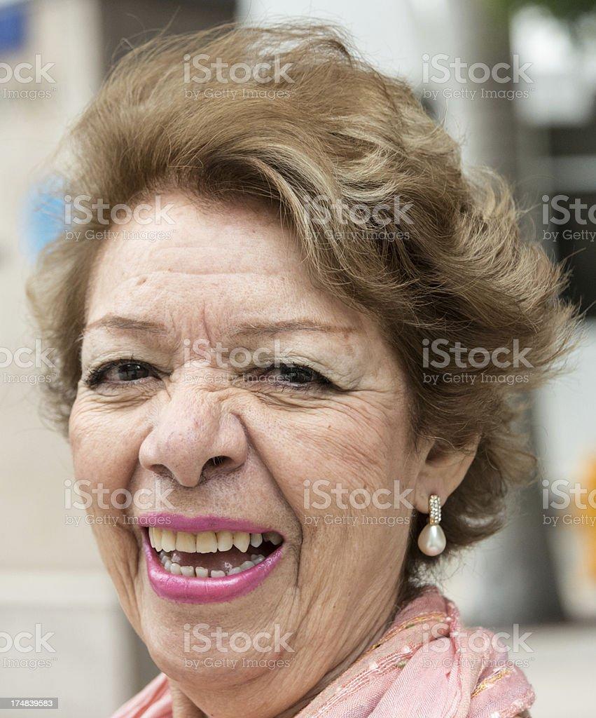 Portrait of a smiling senior hispanic woman outside royalty-free stock photo