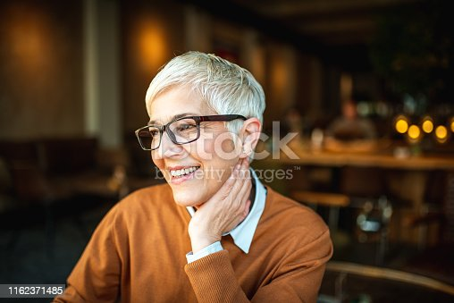 1044149594 istock photo Portrait of a smiling senior woman 1162371485