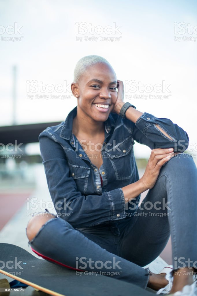 Portrait of a smiling short hair woman. stock photo