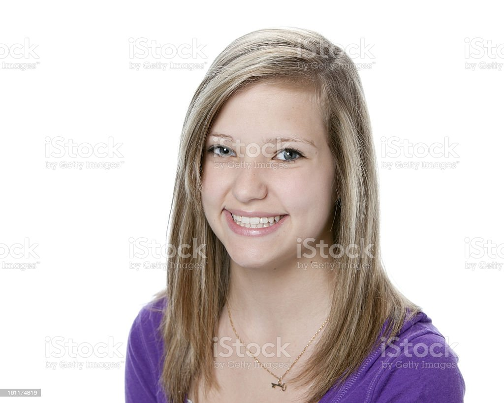 A portrait of a smiling teenage girl, isolated on white stock photo