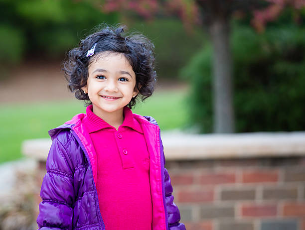 Portrait of a Smiling Toddler Girl stock photo