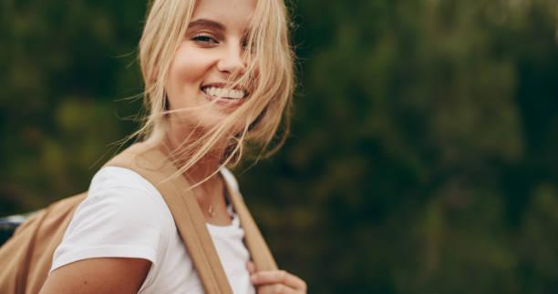Portrait of a smiling woman explorer wearing a backpack picture id1023451166?b=1&k=6&m=1023451166&s=612x612&w=0&h=x4mcokln47xiujv3txche4fkpxr3n jviljow2jgtni=