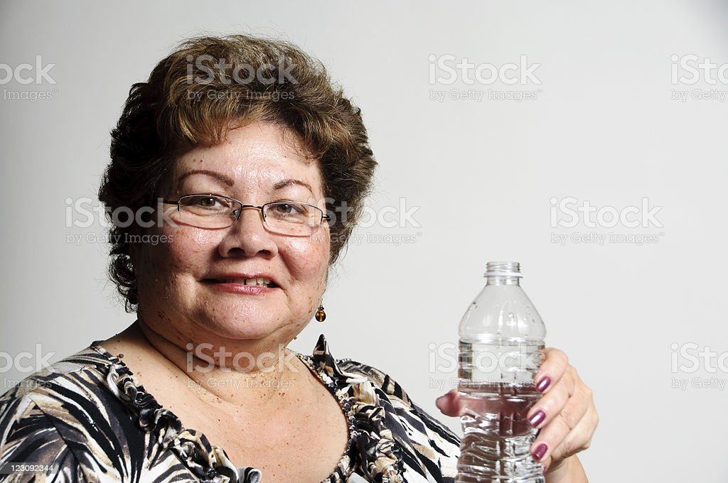 Portrait of a smiling woman holding a water bottle stock photo
