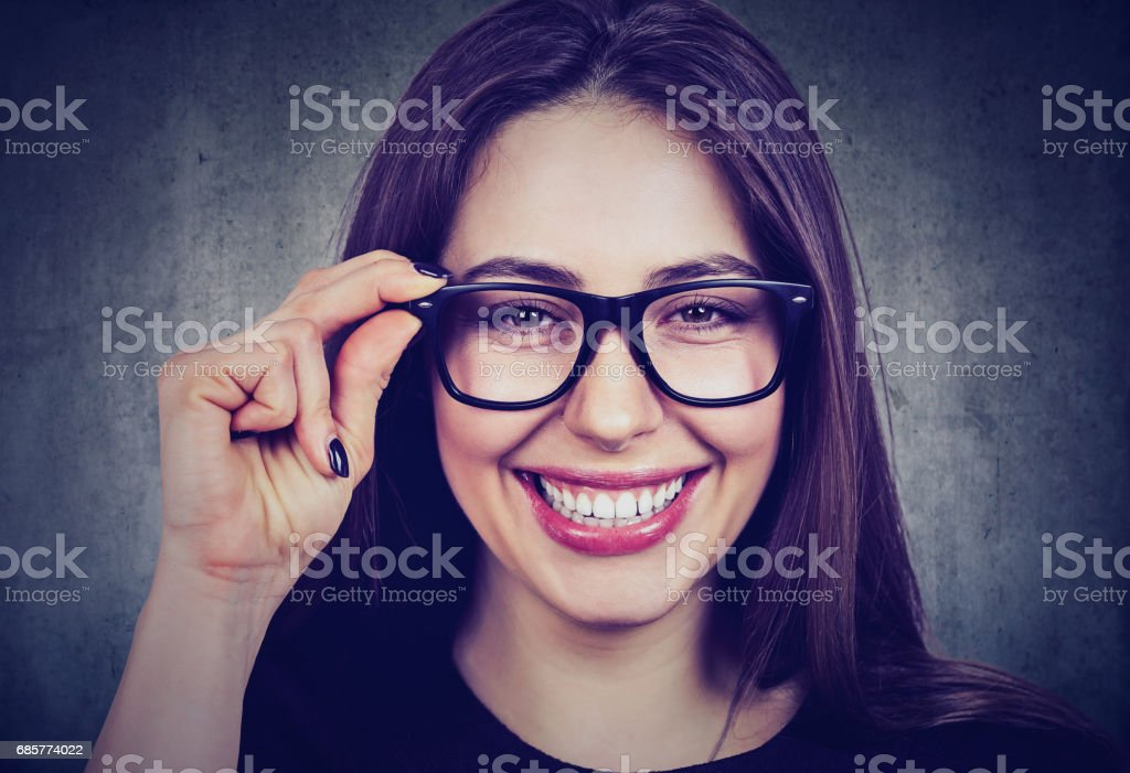 portrait of a smiling woman in glasses royalty-free stock photo