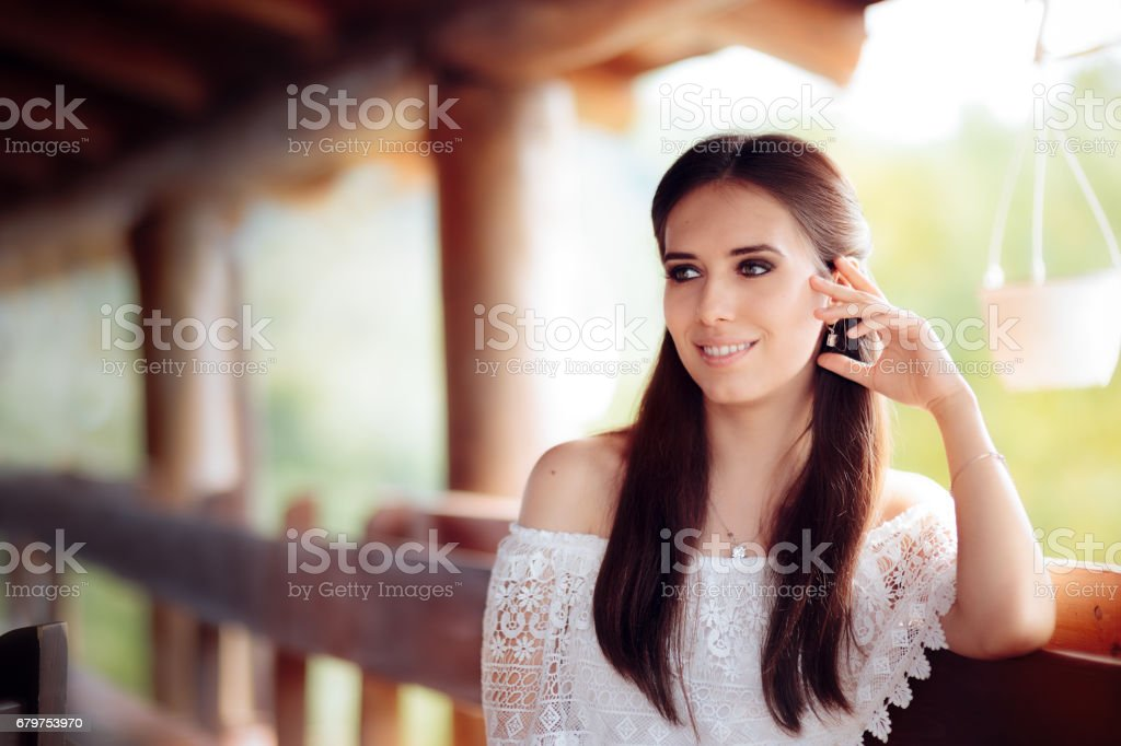 Portrait of a Smiling Woman Wearing White Lace Top stock photo