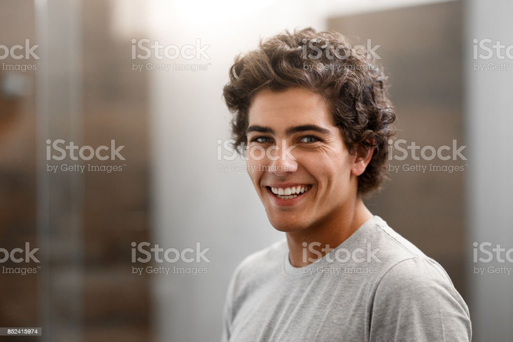Portrait of a smiling young boy in the bathroom stock photo