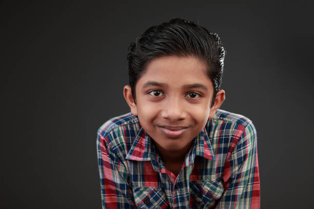 Portrait of a smiling young boy stock photo