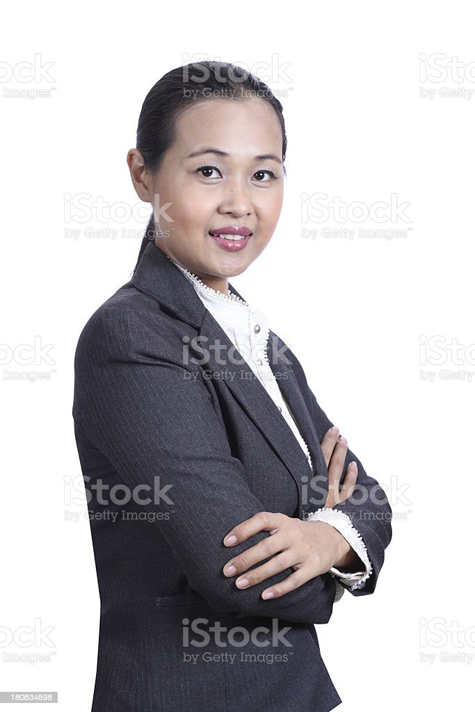 Portrait of a smiling young businesswoman with arms crossed royalty-free stock photo