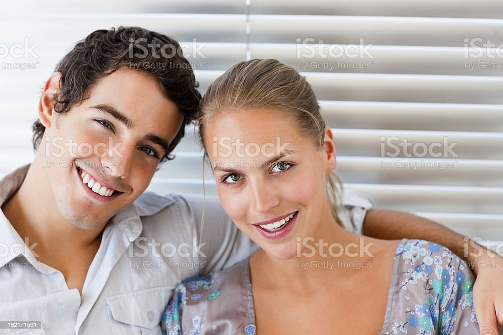 Portrait of a smiling young couple royalty-free stock photo