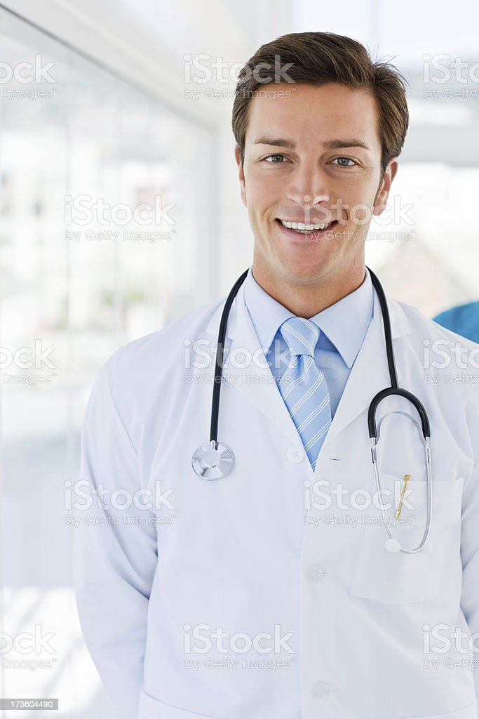 Portrait of a smiling young doctor royalty-free stock photo