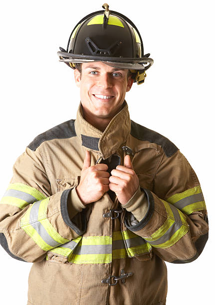 Portrait of a smiling young fireman stock photo