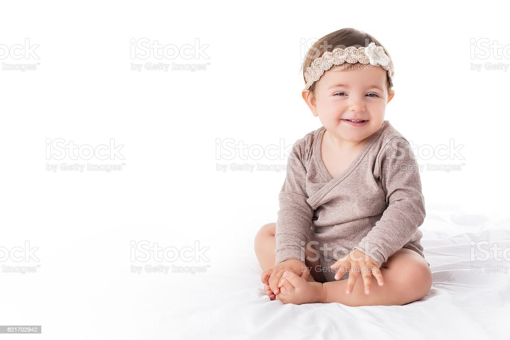 Portrait of a smilling baby girl on a white background stock photo