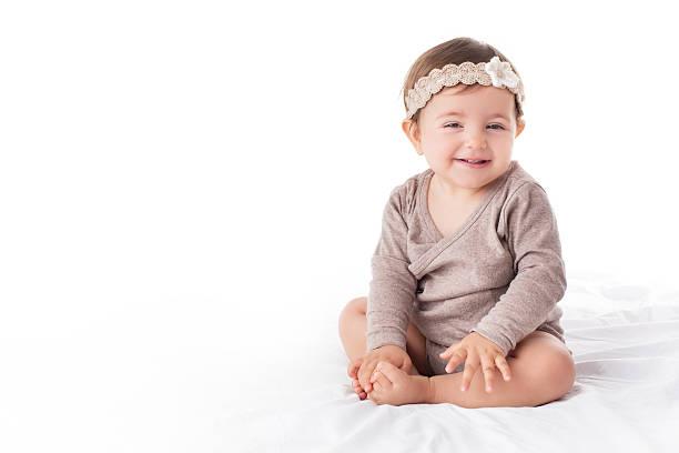 portrait of a smilling baby girl on a white background - kleinkind frisur stock-fotos und bilder