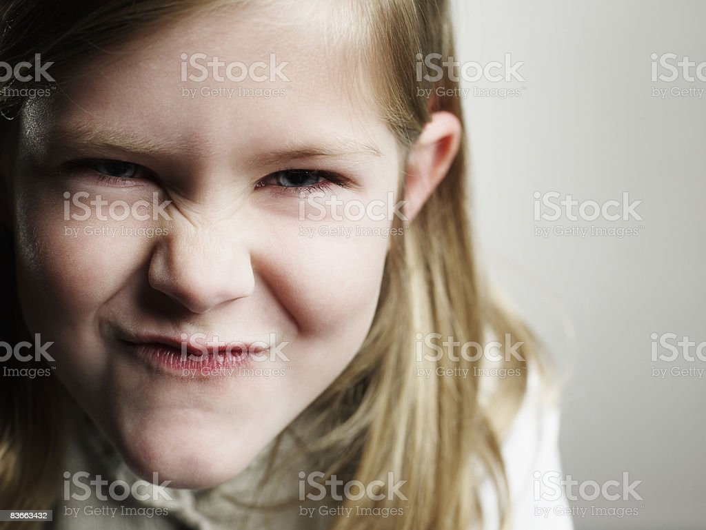 Portrait of a smirking 5 year old girl.  royalty-free stock photo