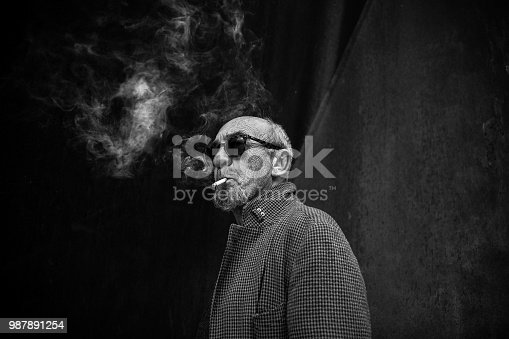 Portrait of a smoking man in black and white.