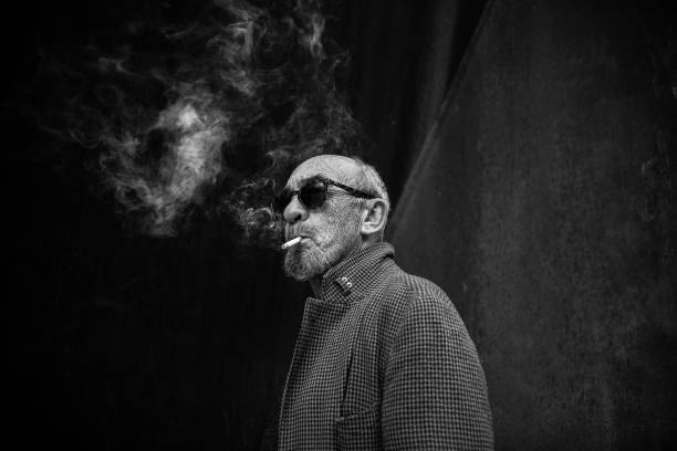 Portrait of a smoking man. stock photo