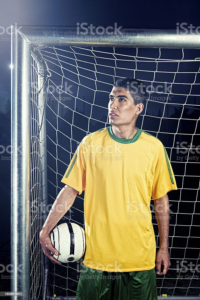 Portrait of a soccer player holding football royalty-free stock photo