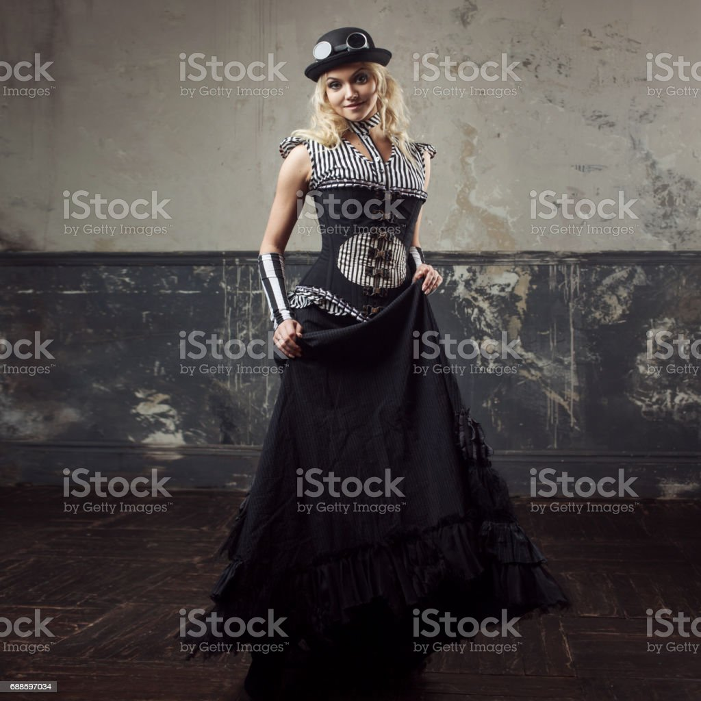 2fbd7f9773c Portrait of a steampunk woman over grunge background. Beautiful lady in a  Victorian style - Stock image .