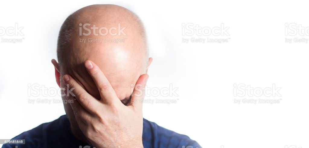 Portrait of a stressed Sad bald man on white background, covering eyes with hands, hair loss baldness, headache, Shame, drowsiness, sleep stock photo