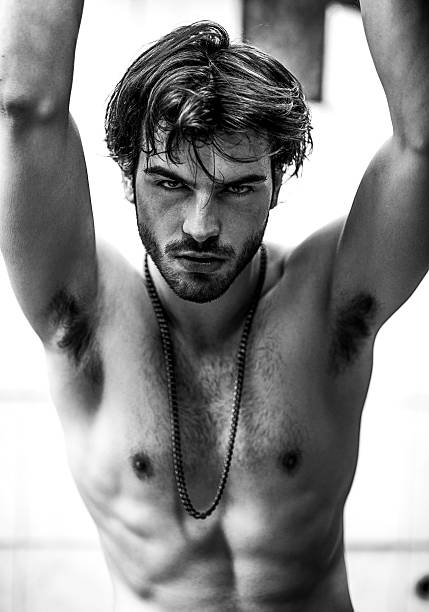 portrait of a strong male model portrait of a strong male model shirtless male models stock pictures, royalty-free photos & images