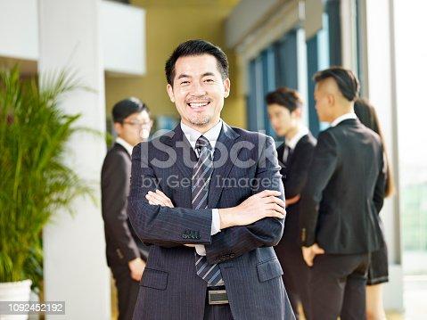 960195072 istock photo portrait of a successful asian businessman 1092452192