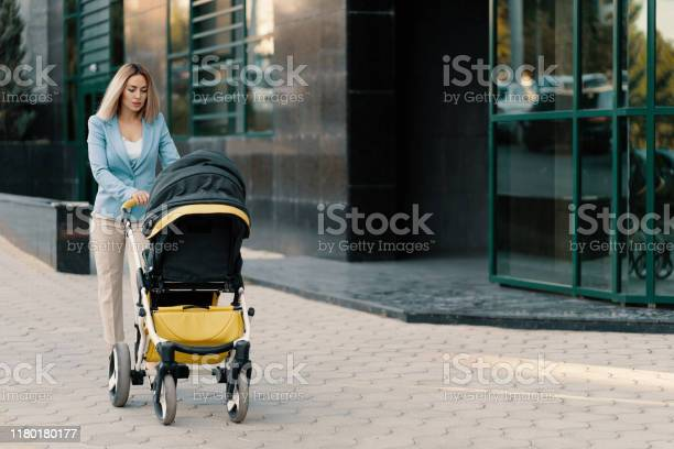 Portrait of a successful business woman in blue suit with baby picture id1180180177?b=1&k=6&m=1180180177&s=612x612&h=8mxa0auu rqwqjftt6dc2mgtjpc20kt93trphk6otyy=
