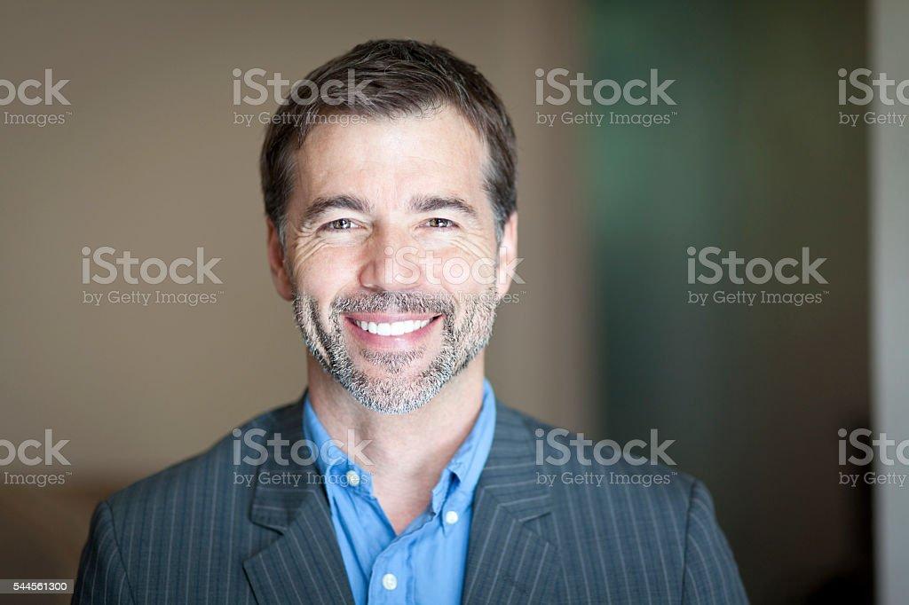 Portrait Of A Successful Businessman Smiling At The Camera Portrait Of A Successful Businessman Smiling At The Camera 40-49 Years Stock Photo