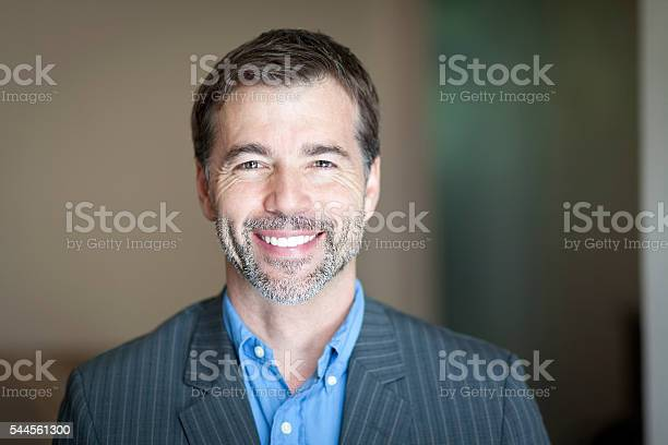 Portrait Of A Successful Businessman Smiling At The Camera Stock Photo - Download Image Now