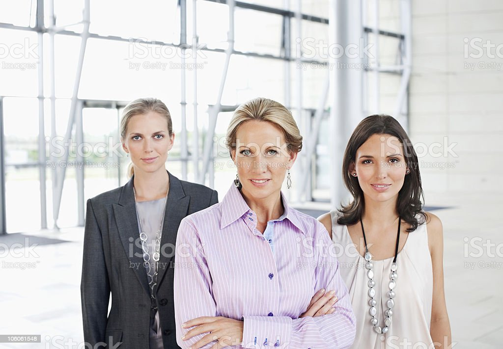 Portrait of a successful businesswoman with colleagues royalty-free stock photo