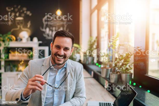 Portrait of a successful entrepreneur holding eyeglasses while at picture id945746406?b=1&k=6&m=945746406&s=612x612&h=e6wdfk2qoqjxpupbqgsew3yo v7keihx5f1yo3gpz9u=