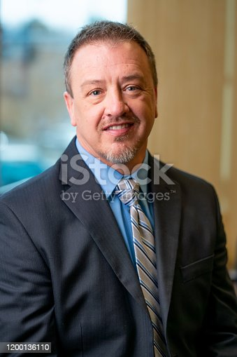 1040964880 istock photo Portrait of a Successful Middle-Aged Man in Business Attire 1200136110