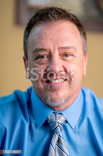 1040964880 istock photo Portrait of a Successful Middle-Aged Man in Business Attire 1200136351