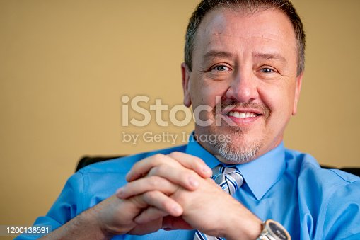 1040964880 istock photo Portrait of a Successful Middle-Aged Man in Business Attire 1200136591