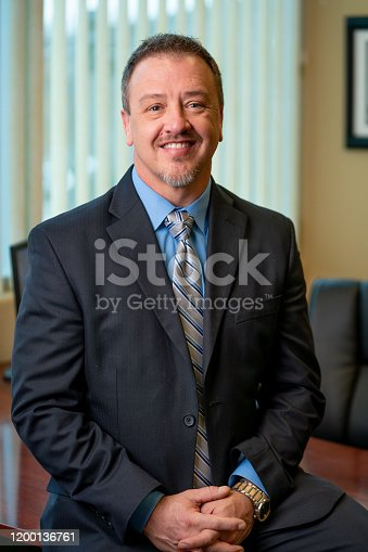1040964880 istock photo Portrait of a Successful Middle-Aged Man in Business Attire 1200136761