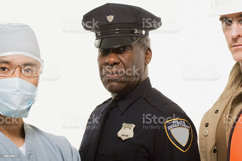 Portrait of a surgeon a police officer  a construction worker stock photo