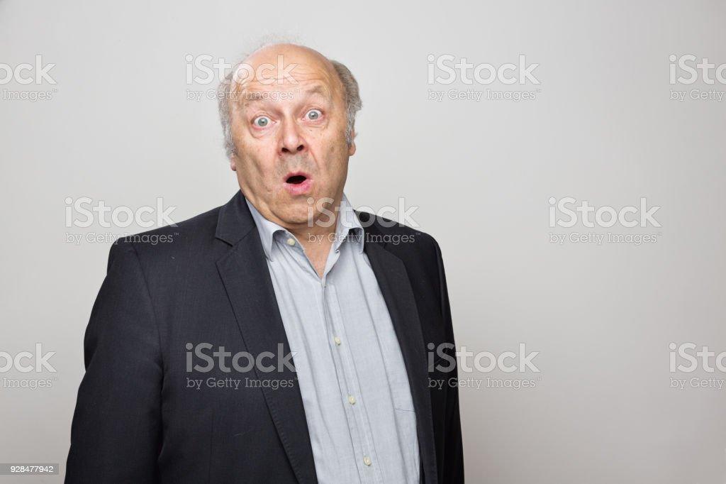 portrait of a surprised senior man stock photo