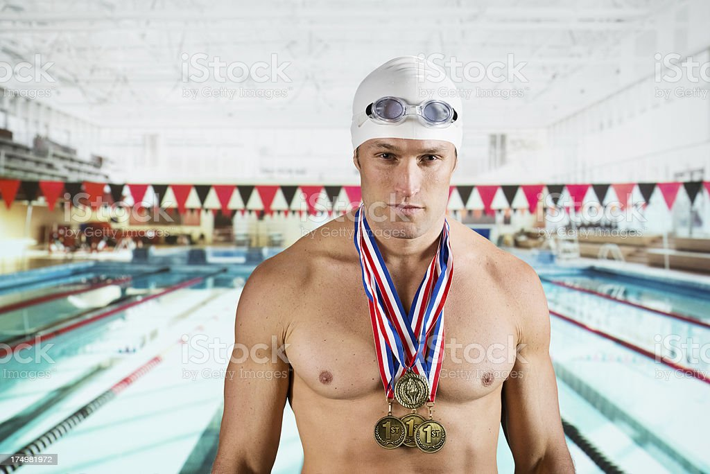 Portrait of a swimmer with medals royalty-free stock photo