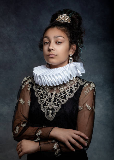 Portrait of a teen girl with dark curly hair, wearing a ruffled collar and  dress in vintage style. Portrait of a teen girl with dark curly hair, wearing a ruffled collar and  dress in vintage style. renaissance stock pictures, royalty-free photos & images