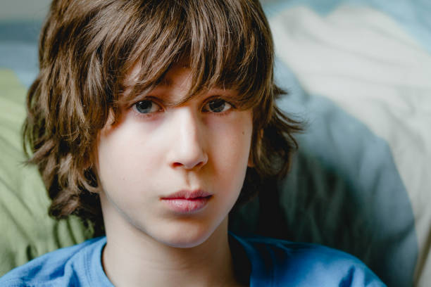 Portrait of a teenage boy one teenage boy only, 12-13 years, teenager, portrait 12 13 years stock pictures, royalty-free photos & images