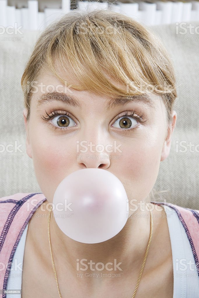 Portrait of a teenage girl blowing bubble gum royalty-free stock photo
