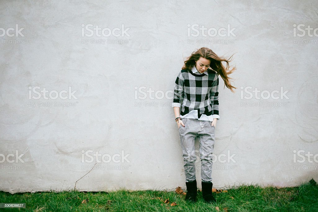 portrait of a teenage girl, looking down stock photo