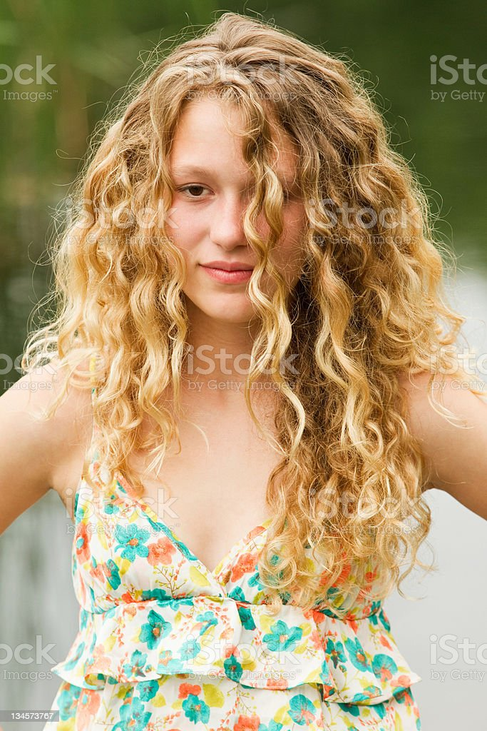 Portrait of a teenage girl with a glazed expression stock photo