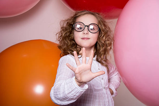 Portrait of a teenage schoolgirl showing stock photo