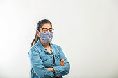 During Covid-19 pandemic spread in India, a girl with face mask staying at home