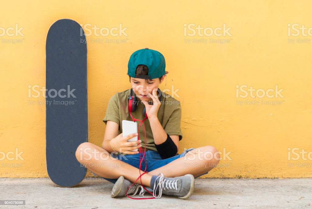 Portrait of a teenager sitting on the floor on a street road cha stock photo