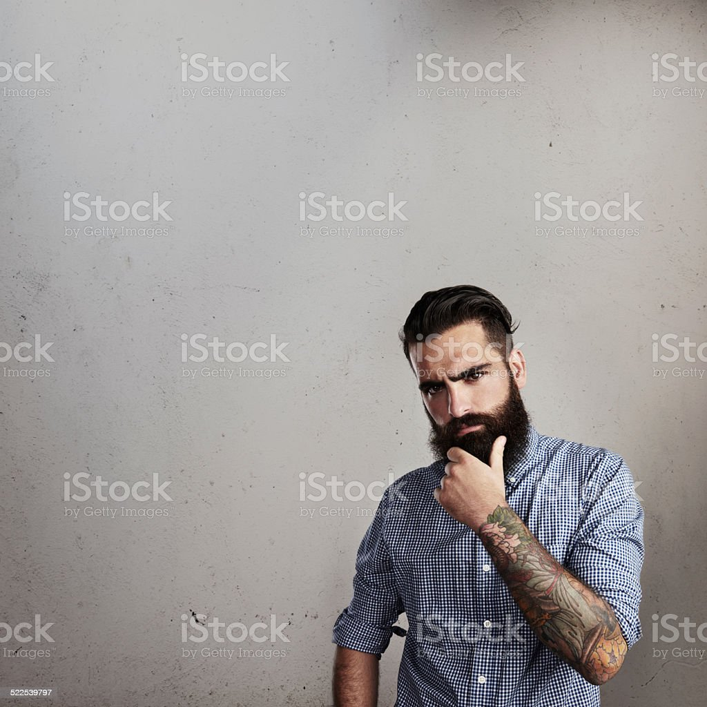 Portrait of a thoughtful bearded man stock photo