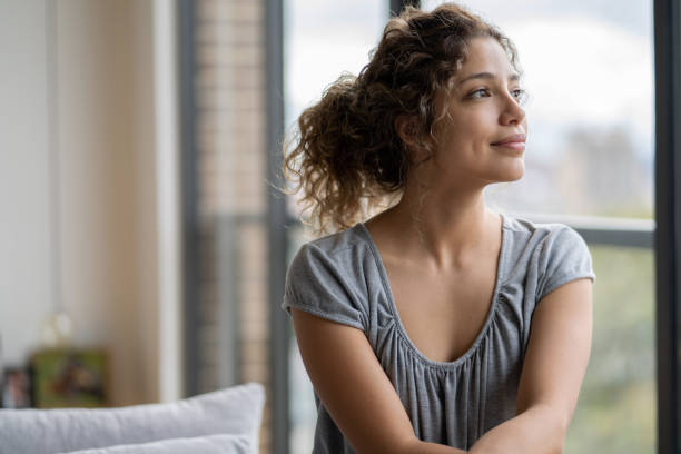 Portrait of a thoughtful woman at home during quarantine stock photo